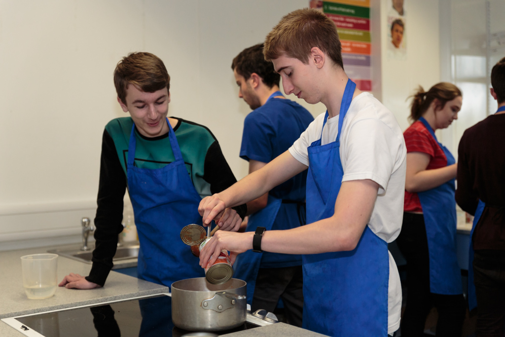 Students cooking a meal