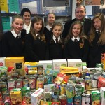 Students with their contributions to the foodbank