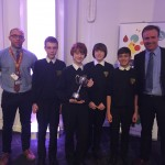 Winning students with their business trophy