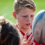 Student catching a Rugby ball