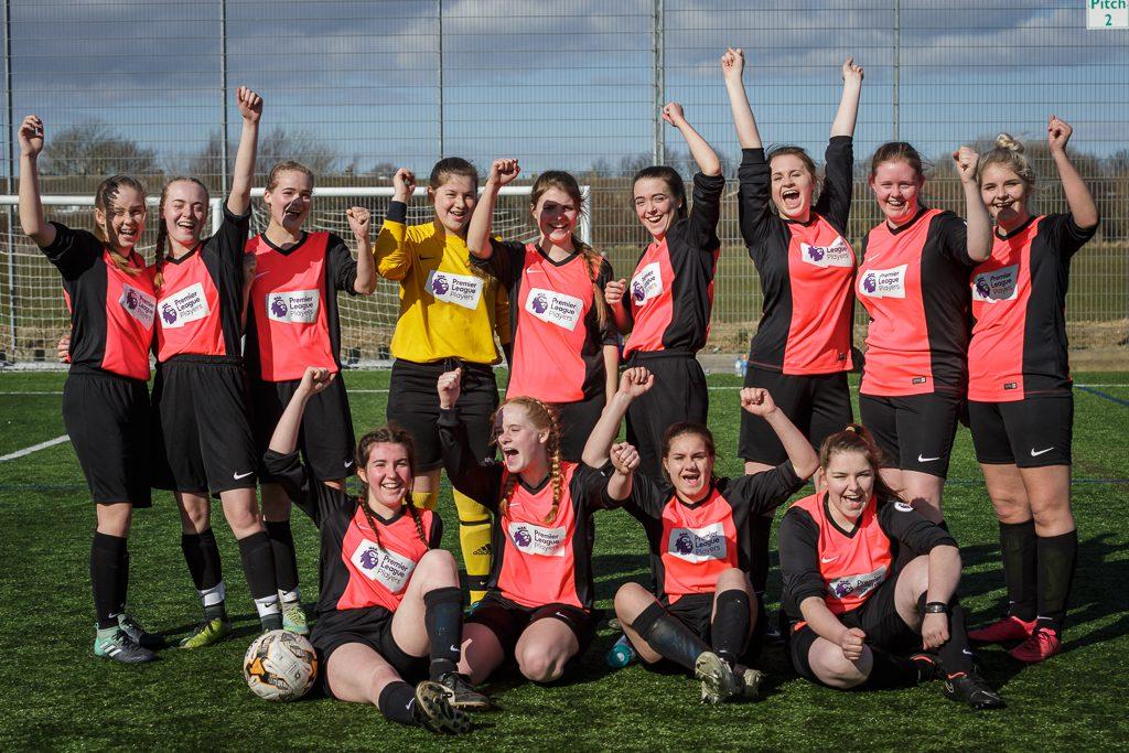 U16 Girls football team celebrating