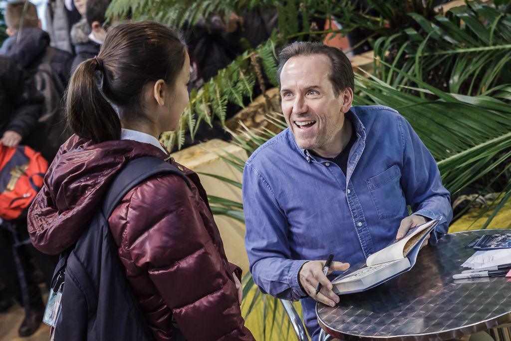 Actor Ben Miller signs book for students during his book event