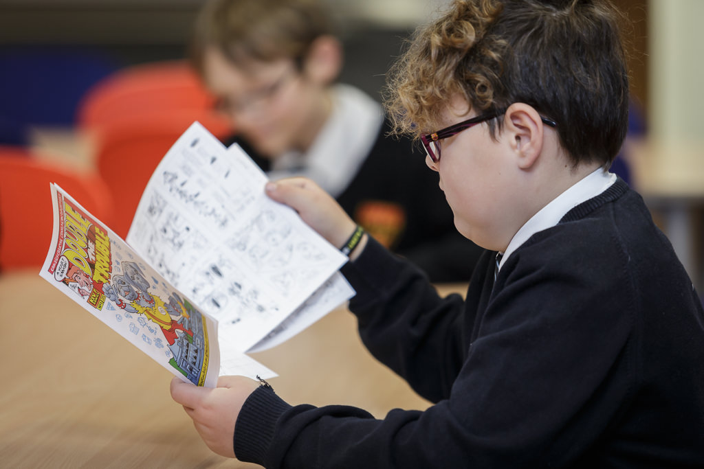 Student reads their finished comic book