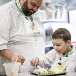 Chef Matei Baran and his son prepare a meal