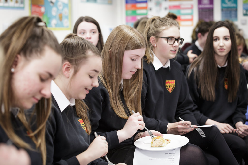 Students sampling cooked food
