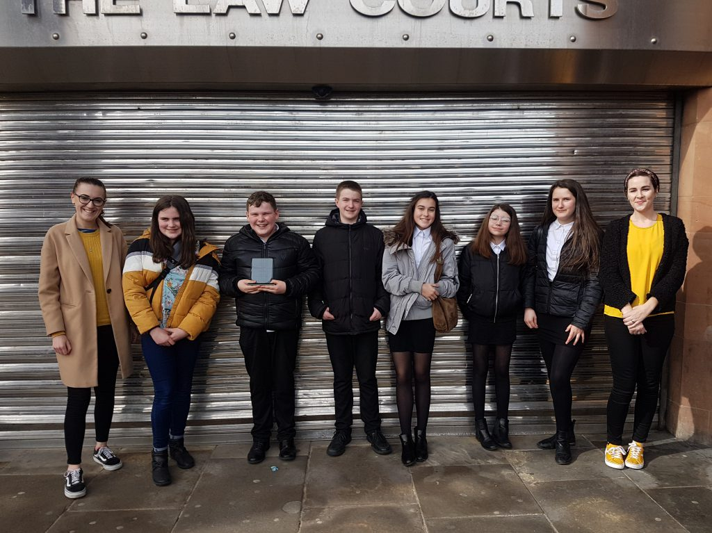 Students outside Newcastle Law Courts with their winning trophy
