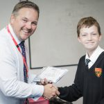 Mr Clark and a year 7 student receiving a certificate