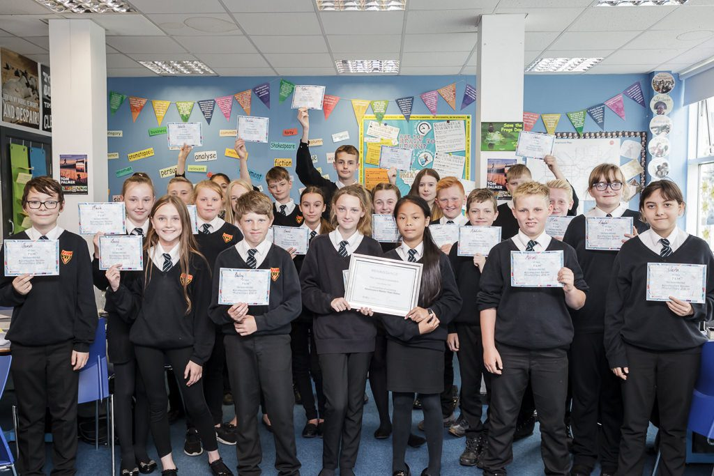 Year 7 class in a group holding their certificates